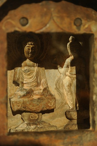 Lord Buddha and Quan Yin in stone shrine enclosure on pedestals, Art Institute of Chicago, Illinois, USA by Wonderlane