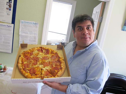 Jorge with a pizza from Pizzacare,