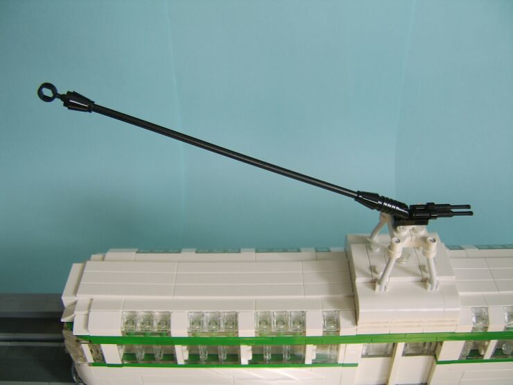 View of the roof of the tram aswell as the trolley arm and trolley tower of a LEGO® model of a Blackpool Coronation tram