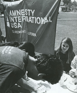 Darcy Nagle '89 signs up a new member for Amnesty International during the 1988 Activities Faire.