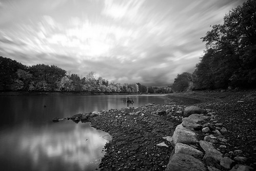 longexposure trees blackandwhite lake motion reflection fall water monochrome clouds speed landscape bed rocks sweden dam tripod shoreline shell overcast nopeople clam explore motionblur le stump grayscale scandinavia hydroelectric drained sigma1020mm calmwater ndfilter lakescape svartån neutraldensity explored ireffect nordics vretakloster cloudmotion kraftverksdamm lightcraftworkshopnd500 sonyalphaslta77 mjölorp mjölorpesjön