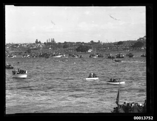 Coxed fours racing before a large crowd, Sydney