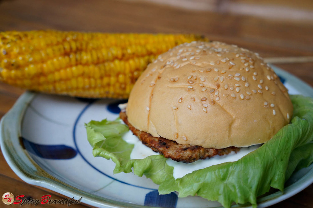 Chicken Burger with a side of Grilled Corn