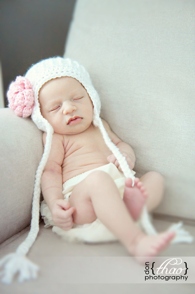 precious baby girl with parents, newborn photography in michigan