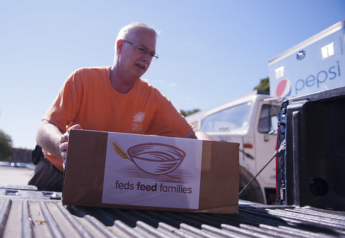 U.S. Coast Guard retired Chief Bill Martin packs a truck with boxes of donated food and household items to be given to a local community food bank in New London, Conn., Sept. 10, 2012. Academy staff and faculty participated in the government-wide Feds Feed Familiies campaign to give back to the community. U.S. Coast Guard photograph by Petty Officer 3rd Class Diana Honings.