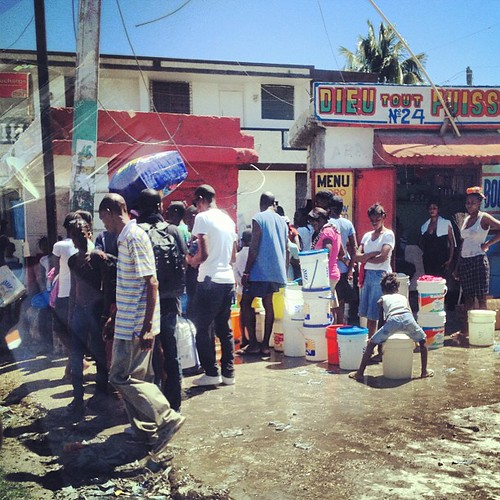 Waiting for clean water. Port-au-Prince.
