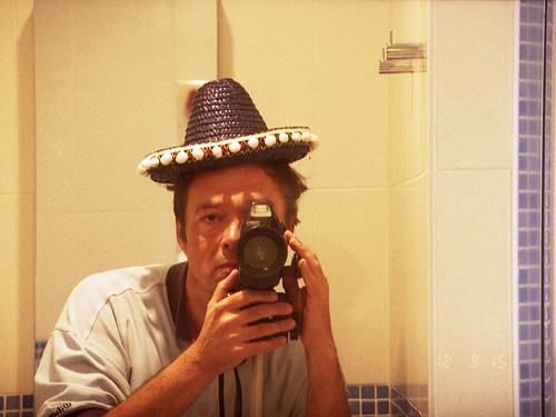 reflected self portrait with Samurai X4.0 camera and diminutive sombrero by pho-Tony