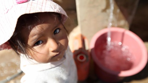 Child at public water station, el Alto, Bolivia, 2012. Video Still: Stephan Bachenheimer / World Bank