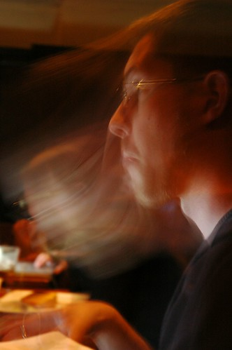 Joel thinking, so fast he's a blur, iSchool Study group, University Inn, Seattle, Washington, USA by Wonderlane