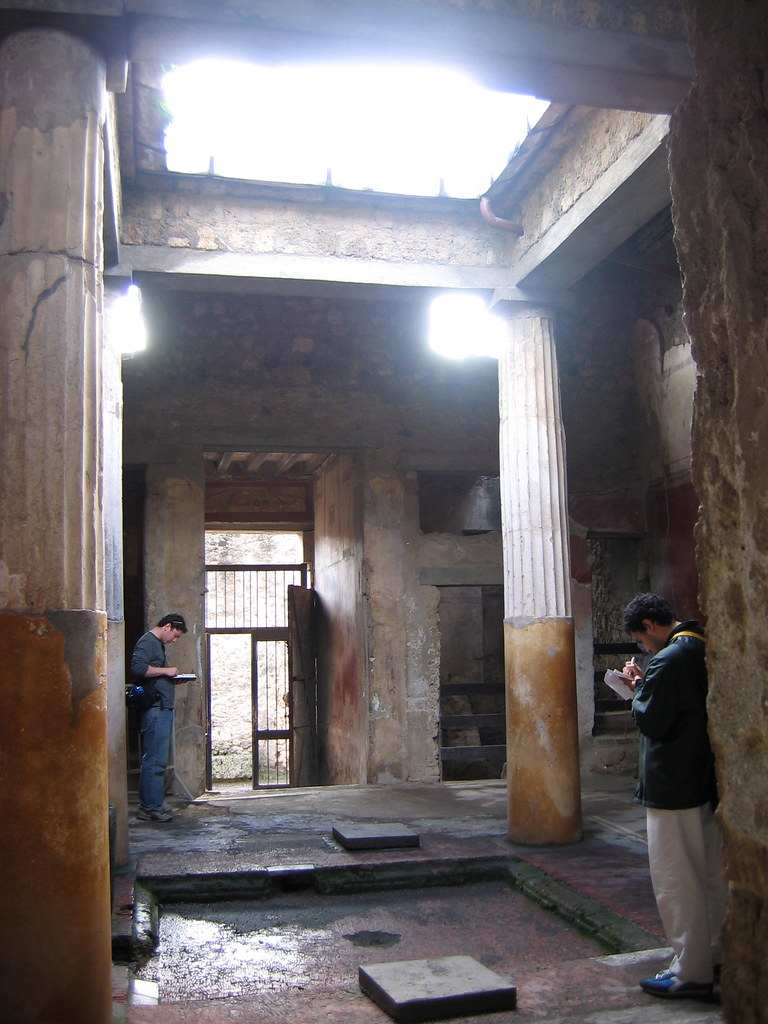 Architecture students Noel Salinas and Adam Greene sketching in Pompei, fall 2004.  photo / Troy Rog-Urman (B.Arch. '06)