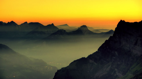 sunset red orange mountains alps yellow misty fog switzerland day walensee churfirsten