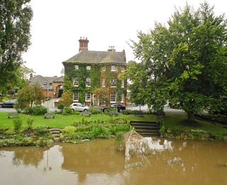 Hotel's garden under water by the River Severn at Atcham Bridge