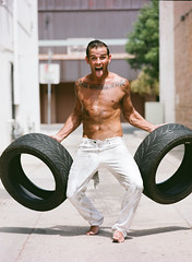 wheel(0.0), tire(1.0), automotive tire(1.0), clothing(1.0), strongman(1.0), muscle(1.0), physical fitness(1.0), person(1.0),