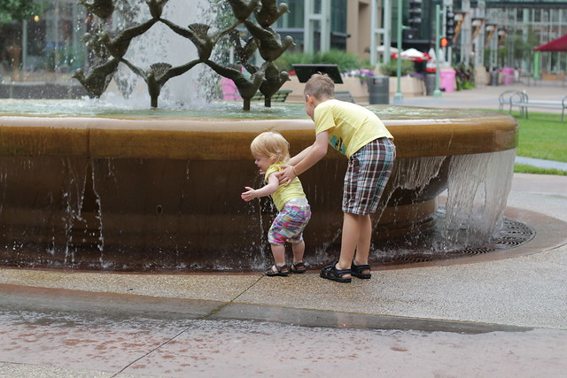 Benjamin and Lucy enjoying Peace Fountain in downtown Rochester