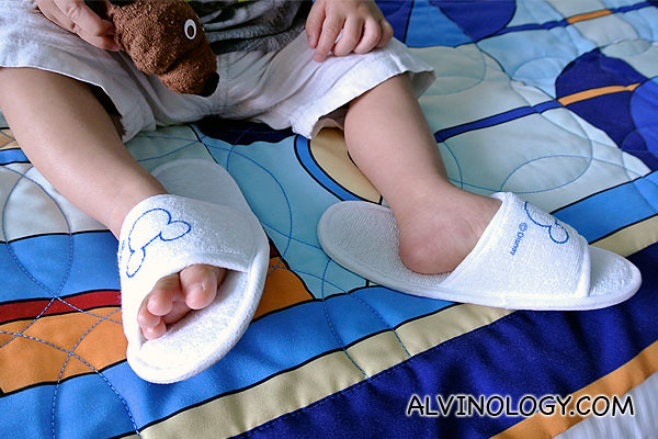 Asher in his baby size Disney bedroom slippers