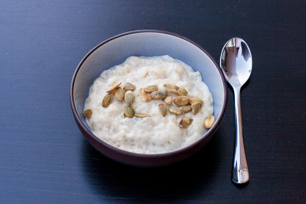 Creamy rice pudding topped with toasted pumpkin seeds