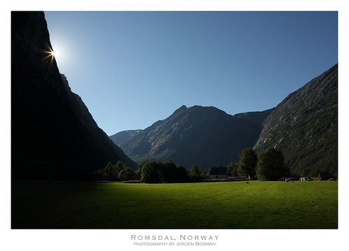 romsdal norway sunrise mountains light green valley dark