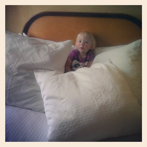 Elliora immediately climbed up on the bed and made a nest of the pillows.