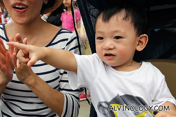 Asher excitedly pointing at the parade