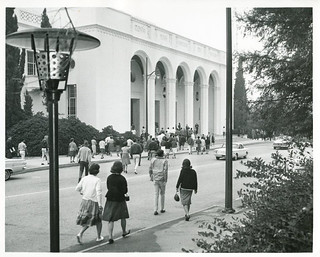 Students walk to the west entrance of Bridges Auditorium on Founders Day 1963.