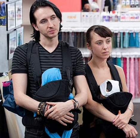 Elena and Dmitry holding their robot babies.