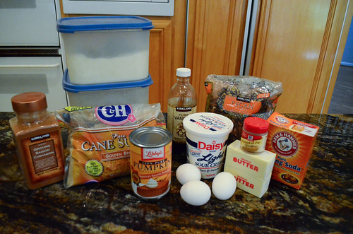 All the ingredients for Pumpkin Streusel Pound Cake arranged on a counter top.