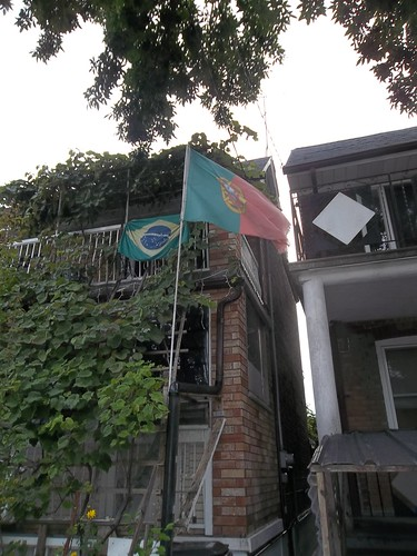 The flags of Brazil and Portugal on Ossington Avenue