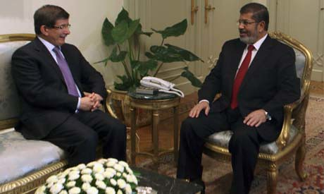 Egyptian President Mohamed Morsi on a state visit to Turkey holds talks with Foreign Minister Davotoglu. The new president has been traveling around the world. by Pan-African News Wire File Photos