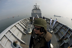 Fire Controlman 2nd Class John Rutherford stands watch as USS Cowpens (CG 63) makes its way into Jakarta, Indonesia, Oct. 7 for a port visit. (U.S. Navy photo by Mass Communication Specialist 3rd Class Paul Kelly)