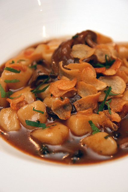 Ricotta Gnocchi with mushroom broth, black garlic and Shimeji mushrooms