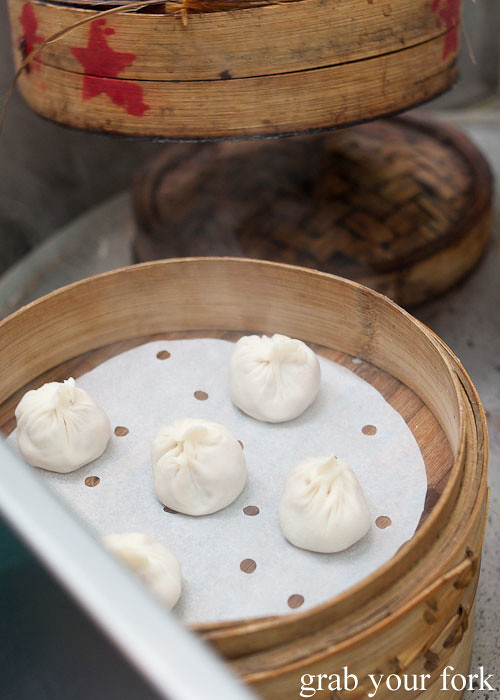 xia long bao soup dumplings at lau pa sat festival market hawker market singapore