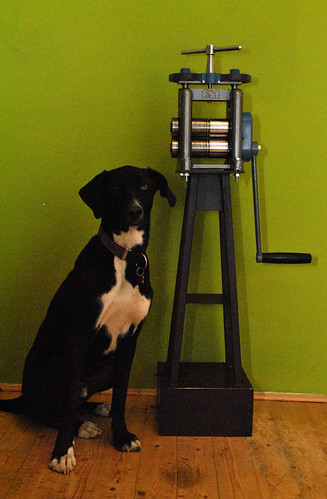 kutya és présgép
