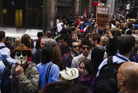 Occupy Wall Street demonstrators in the financial district of New York City. The demonstration attempted to block people from entering the banking district of Lower Manhattan. by Pan-African News Wire File Photos