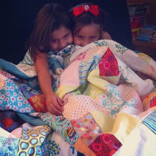 Cuddling in their new quilts!