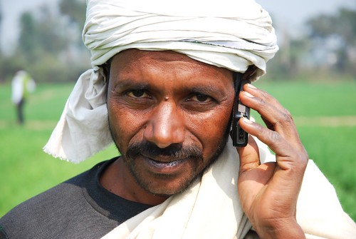 Farmer with his mobile phone in Bihar India