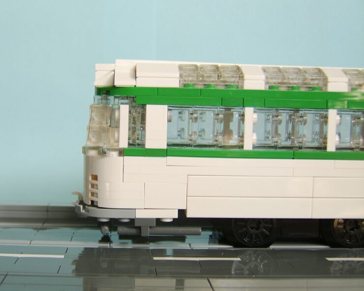 A close up from the side view showing the slight angle to the front windscreen of a LEGO® model of a Blackpool Coronation tram