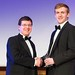 Nick Kay receiving an award from NPL's Martyn Sene