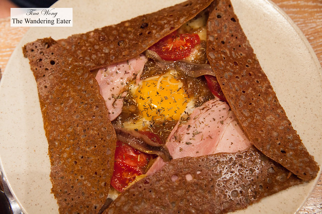 Provencale -Onion confit in cider, tomatoes, ham, anchovies, raw milk Gruyere cheese, sunny side up egg, herbes de Provence