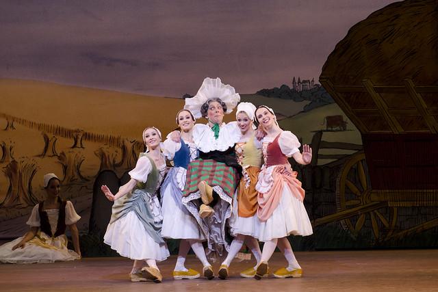 Will Tuckett as Widow Simone and Melissa Hamilton, Emma Maguire, Sian Murphy and Kristen McNally as clog dancers in La Fille mal gardée, The Royal Ballet © ROH/Tristram Kenton, 2012
