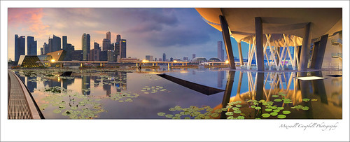 city sunset sky panorama reflection water architecture clouds canon buildings landscape lights pond singapore asia cityscape science highrise marinabay marinabaysands