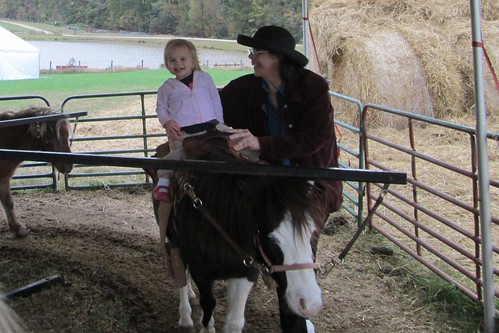 Lucy's first pony ride (with assistance from Mimi)