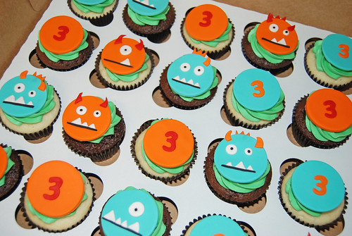 orange red and aqua blue 3rd birthday monster cupcakes