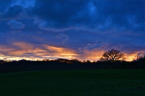 trees light sunset sky orange sun green nature clouds digital canon dark landscape eos rebel xt vermont strip vt pawlet