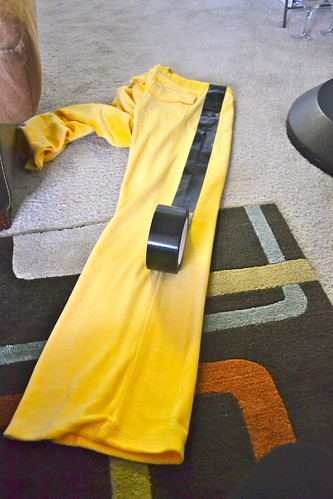 Step 2: duct tape stripes onto a yellow tracksuit