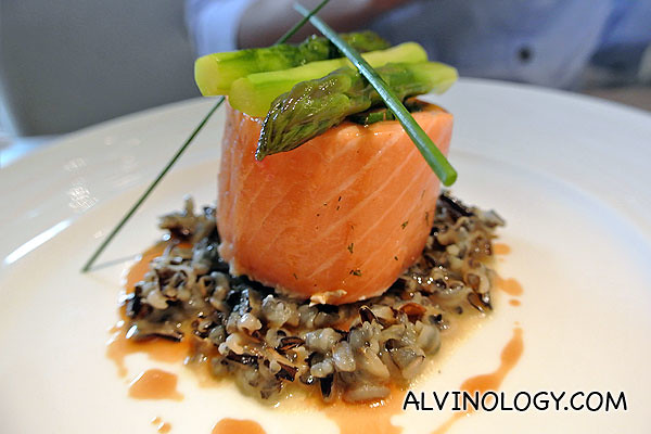 Confit of Salmon Roulade with Soft Herbs, Wild Rice, Hazelnut Oil and Poultry Jus