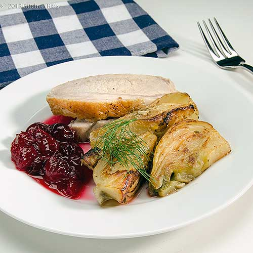 Braised Fennel on Plate with Roast Pork and Cranberry Sauce