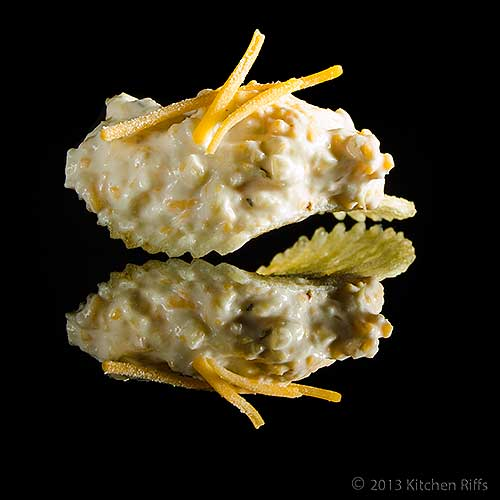 Artichoke Dip with Cheddar Cheese on Potato Chip, On Black Acrylic
