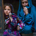 Portrait of an afghan girl with her grand mother in a pamiri house, Badakhshan province, Qazi deh, Afghanistan by Eric Lafforgue