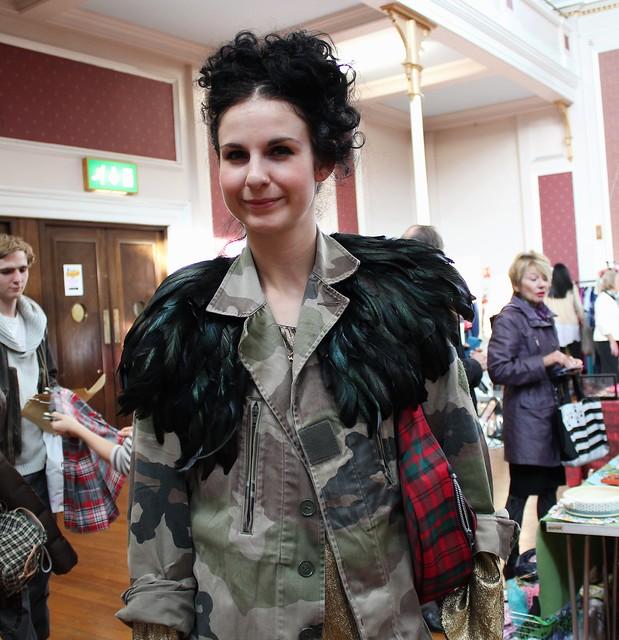 Camo feather jacket, tartan handbag & paint splash leggings: Street Style