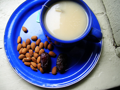 green tea with almond milk, dates, and almonds